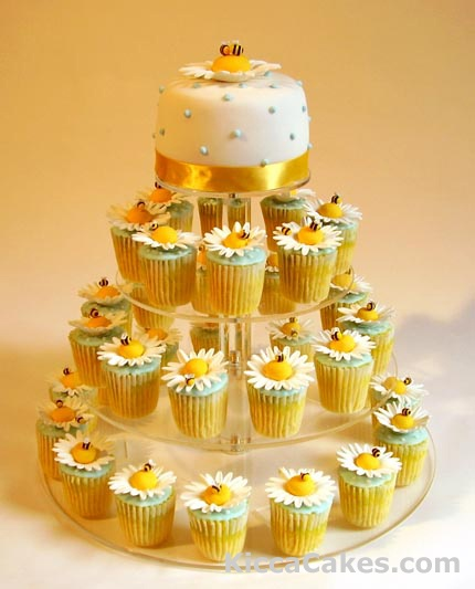So cute...Daisies and Bees Cupcakes~  http://www.wedding-cakes-london.co.uk/Wedding_Cakes/Mini_Wedding_Cupcake/015_Daises_Bees_Cupcakes.html
