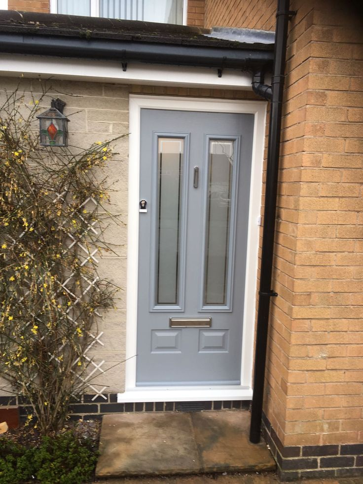 French grey Edinburgh @SolidorLtd Composite Door, satin glass with clear border and chrome pony tail knocker and finger pull handle. Installed in Ruddington, Nottingham. For a free quotation call us on 01158 660066 visit http://www.thenottinghamwindowcompany.co.uk/ or pop into our West Bridgford showroom. #Nottingham #Composite #French #grey #Edinburgh #solidor #composite #doors #front #back #home