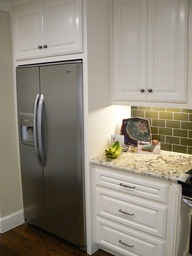 DIY built in fridge but make cabinet with glass doors above fridge for display.
