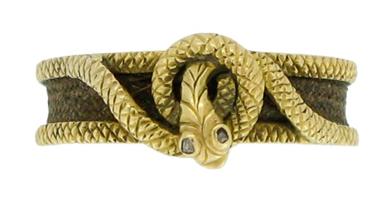 A Victorian mourning ring made of gold and woven hair, 1848, featuring an entwined snake, symbol of eternity.