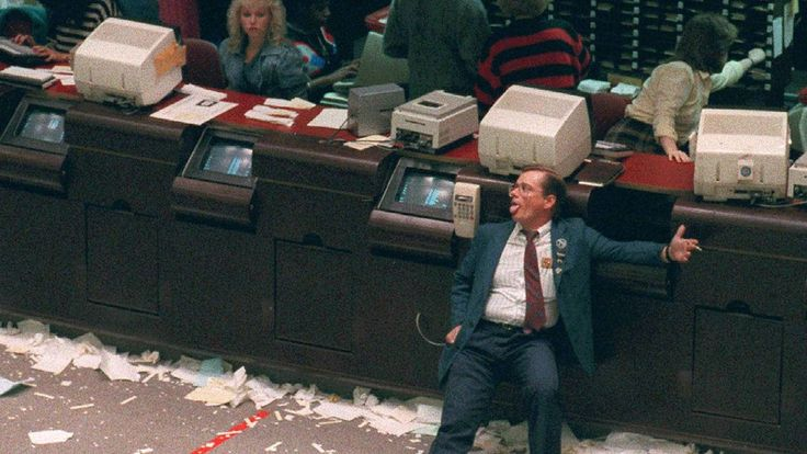 """An exhausted trader at the end of the worst day in stock market history, """"Black Monday"""", October 19, 1987. After """"Black Monday"""", stock exchanges instituted circuit breakers, or trading pauses, when there are large declines."""