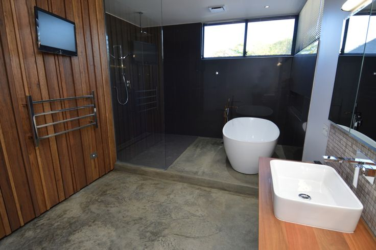 Everyone's dream - a TV positioned so you can watch while in the bath, a heated towel ladder and a lovely spacious bathroom