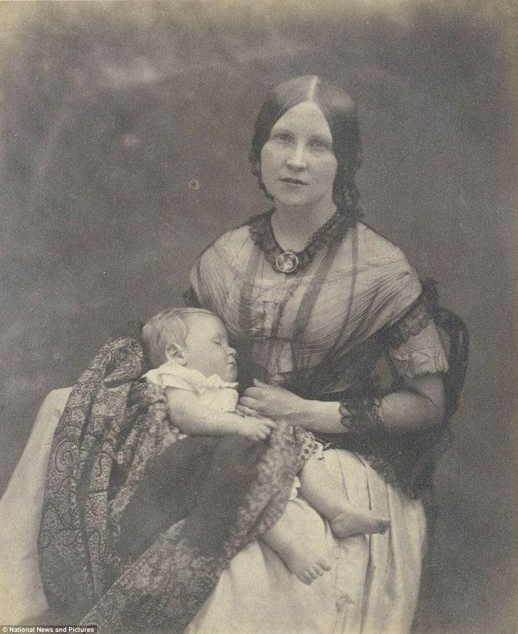 A mother poses for Miss Johnston while her young son has a nap and remains completely obli...