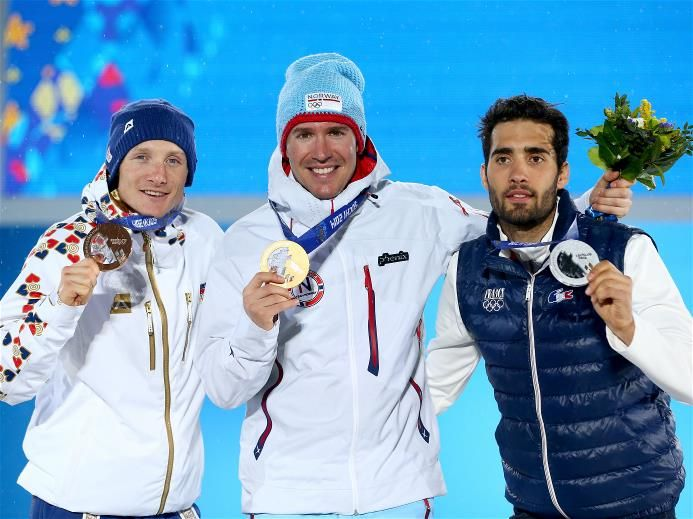 Bronze medlaist Ondrej Moravec of the Czech Republic, gold medalist Emil Hegle Svendsen of Norway and silver medalist Martin Fourcade of France celebrate during the medal ceremony for the Men's 15 km Mass Starton day 12 of the Sochi 2014 Winter Olympics at Medals Plaza