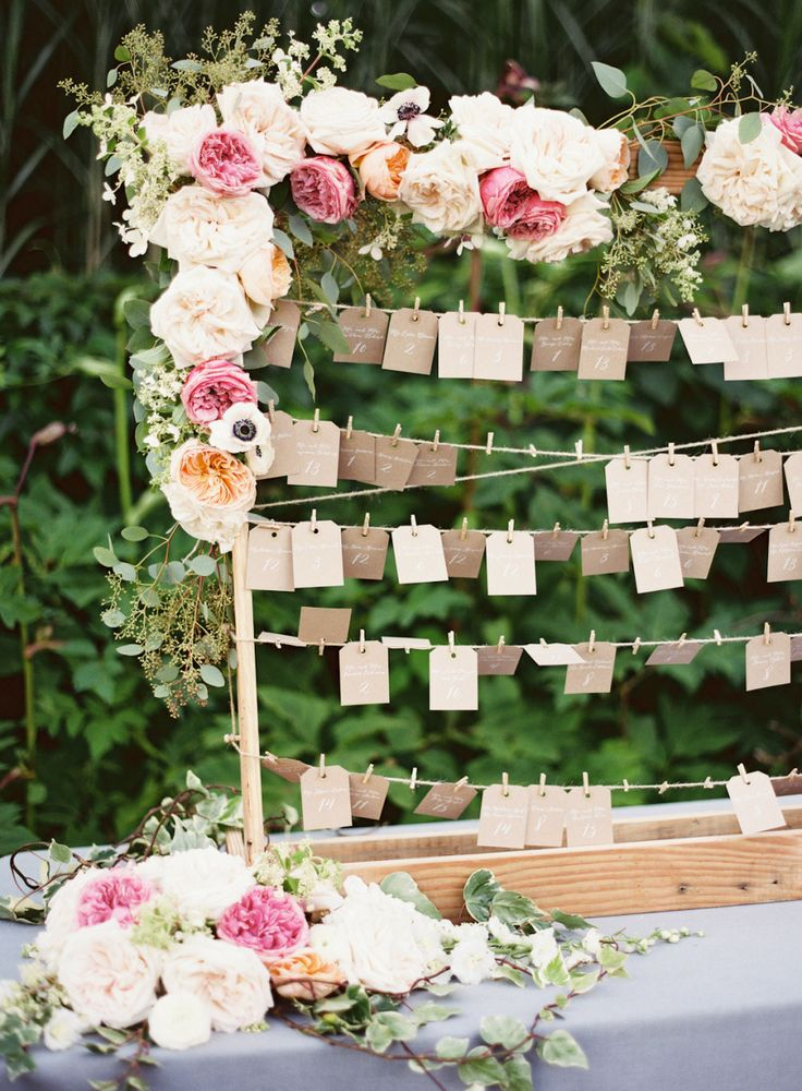 Sweet idea for a garden-themed shower. Escort cards attached with mini clothespins. Lots of flowers.