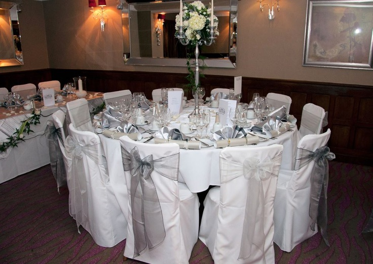 Alternating Platinum and Dark Silver Organza Bows on White Chair Covers.  Photos with thanks to Pho2u!