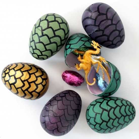 Throwing a Game of Thrones party? Make these easy DIY Dragon Eggs, full of candy and tiny dragons.