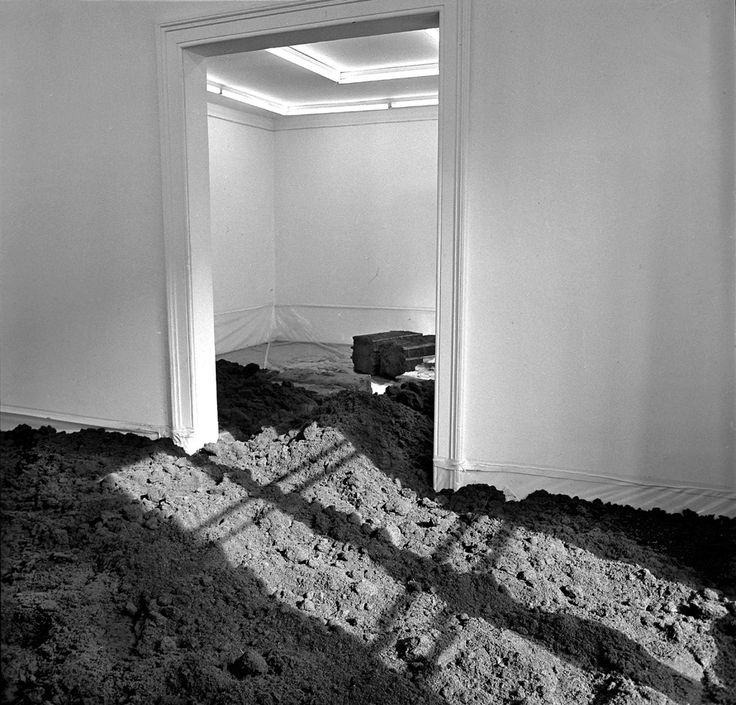 """Walter de  Maria's first """"Earth Room"""" was created in Munich in 1968. Dia Art Foundation originally commissioned the work. The work is described in incredibly logistical and sterile terms: An interior earth sculpture.  250 cubic yards of earth (197 cubic meters) 3,600 square feet of floor space (335 square meters)     22 inch depth of material (56 centimeters)     Total weight of sculpture: 280,000 lbs. (127,300 kilos)"""