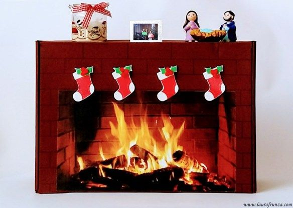 Fake fireplace made of a cardboard box. The fire is printed. Stockings are made of foam.