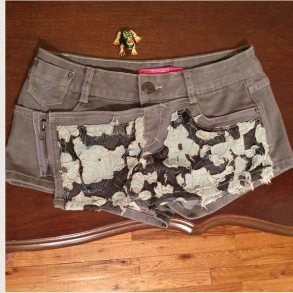 ⭐️Final⭐️NWOT Custo Barcelona Skirt Shorts Brand new Custo micro skirt/shorts.  You can't find these anymore so bask in the glory!  Nice details such as tiny metal skulls, side zipper, angels on back.  The front is multi-material, lace embellished with material made flowers . A lot going on to make this thoroughly modern and thoroughly adult. Custo Barcelona Shorts Jean Shorts