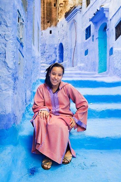 A Moroccan girl wearing traditional djellaba in a traditional street in a Moroccan sea-side city