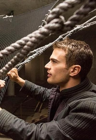 Divergent----This scene is right when Tobias helps Tris down from the net, as she is indeed the first one to jump.