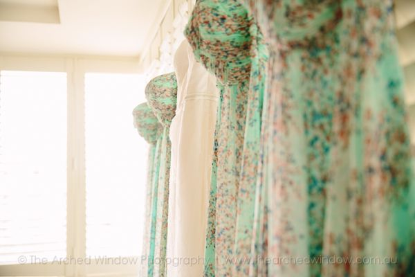 beach style floral bridesmaid dresses. Photography by The Arched Window.