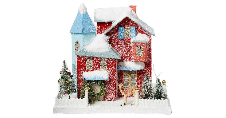A thoughtful gift, this decorative house is trimmed with snow, sparkle, and plenty of holiday spirit.
