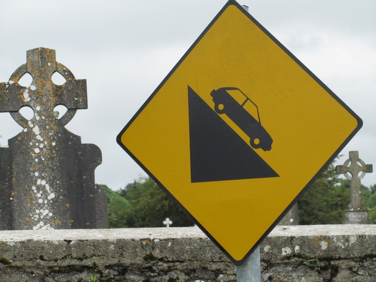 Ominous sign by graveyard.
