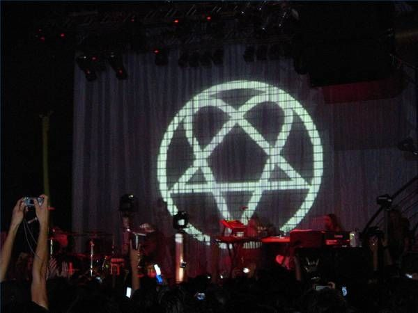What Is the Meaning of the Heartagram?  The Yin and Yang - Love Songs/Metal as related to Rock Music - It has nothing to do with Satan and is not Santic - Not Wiccan - A Logo for the Band HIM created by Ville Valo @ 20 years of age.  Popular Tatoo