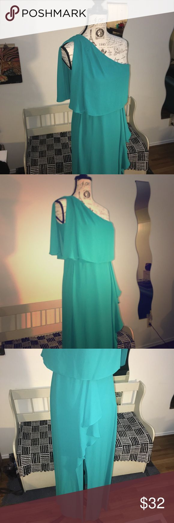 Turquoise one shoulder long Dress Elegant one shoulder dress, is long and it has a long opening On the left leg for a chic look, is flare loose in bust area Dresses One Shoulder