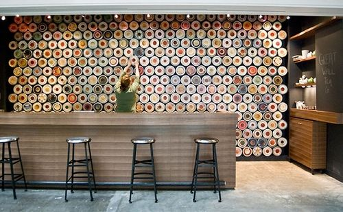 Great Wall Tea Company, New Westminster – Canada. A staggered array of 568 standard tea containers are magnetized to create tea storage, signage and an ever changing display of imagery. Designed by Marianne Amodio