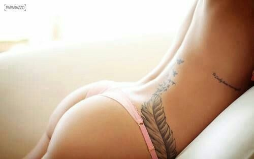 I love this tattoo. I like the way it fits to the curve of her hip and up her back!