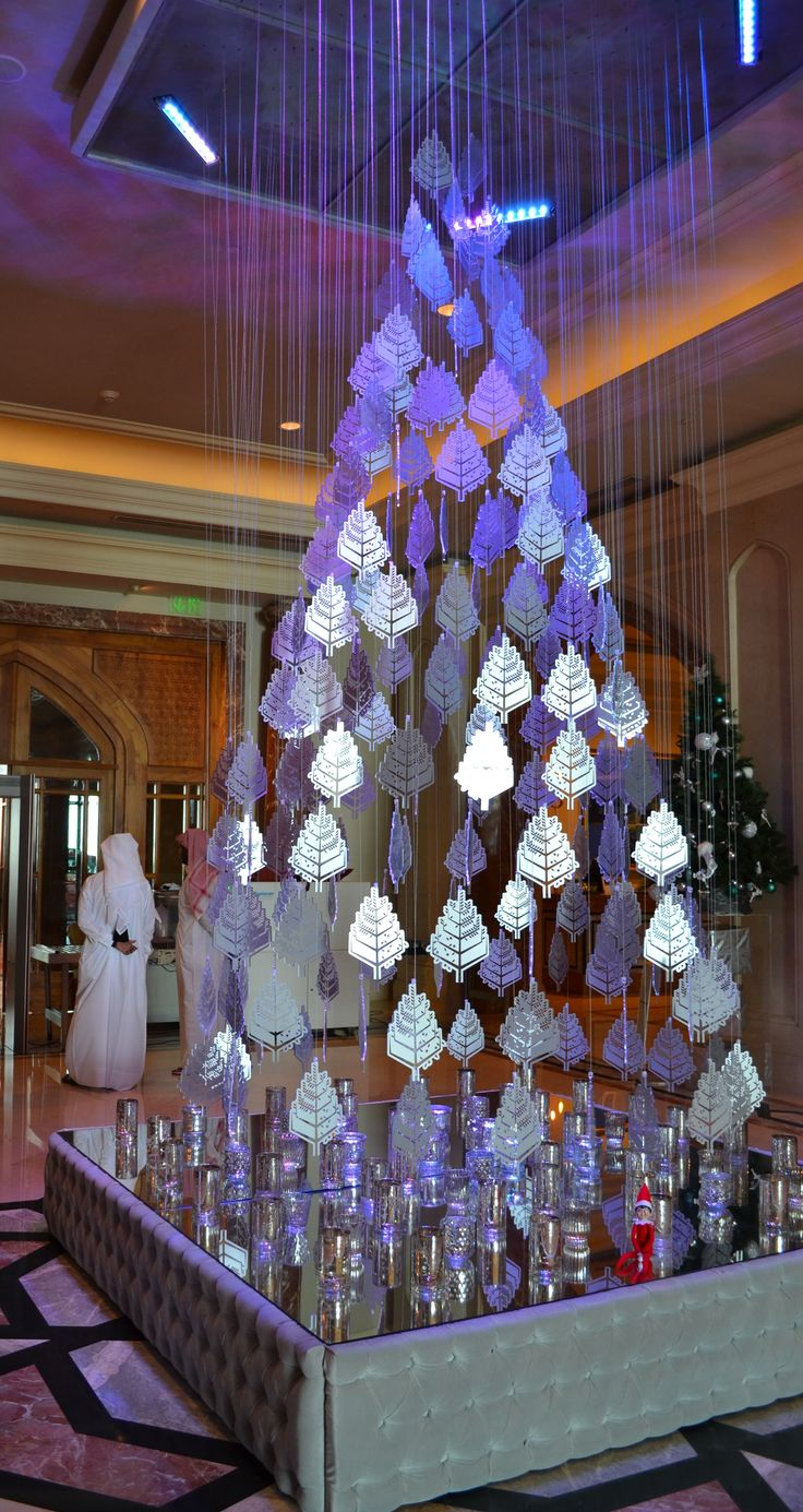 Christmas tree decorations purple silver -  Four Seasons Hotel Doha S Tree Is Shimmering In Silver This Year