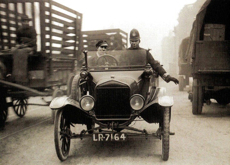 Police use a Ford motor car to regulate slow-moving traffic in the East End of London - 12 October 1920