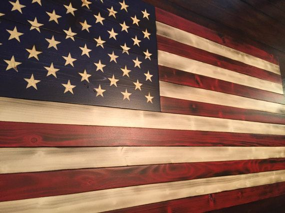 **********************FREE SHIPPING*******************************  ALL AMERICAN FLAG  Each custom Wooden American Flag is perfect for your own home decor and also makes a great gift! Each star is HAND-CARVED with meticulous detail to show my Veteran pride. All flags have FREE SHIPPING!  *Product Details / Dimensions*  Image shown is approximately 19 1/2 H x 38 W Each piece of wood is hand burned and stained to perfection Each flag has a 2 coat satin finish, which protects the wood,...