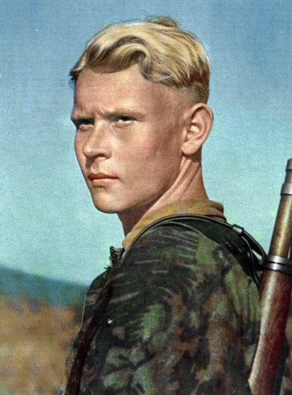 He was of the Aryan Race - A German soldier from WW2 featuring blonde hair, blue eyes, long head, a smooth straight nose, and presumably tall stature - the stereotyped physical appearance of the Nordic race, which was said to be the most pure sub-race of the Aryan race.