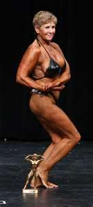 Older women competes in bodybuilding competition