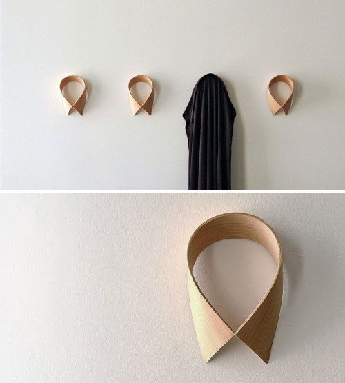 monsieur dressup is a unique coat rack design by anna thomas which features collar cuff and pocket shaped wall hooks that are made from maple