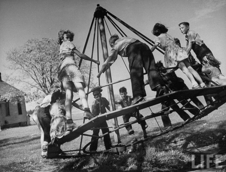 Children playing on an ocean wave at recess. Illinois, 1946. ByBernard Hoffman
