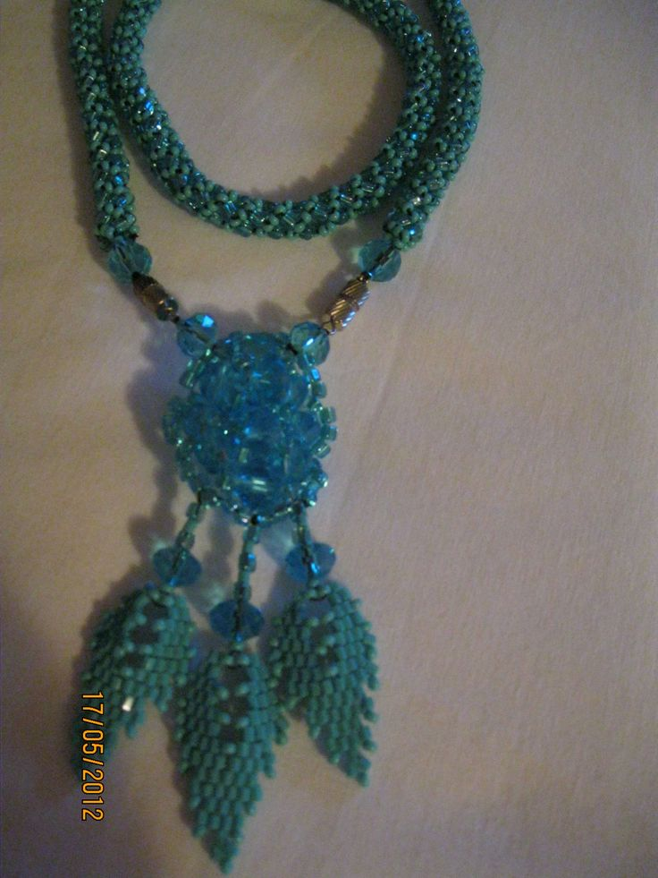 Turquoise pendant with leaves