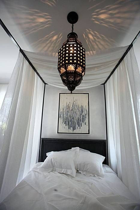 Moroccan lantern in bedroom by wick design