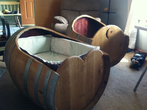 baby cradle made from a wine barrel. wine barrel furniture. crib. bassinet. baby bed. baby furniture. on Etsy, $550.00