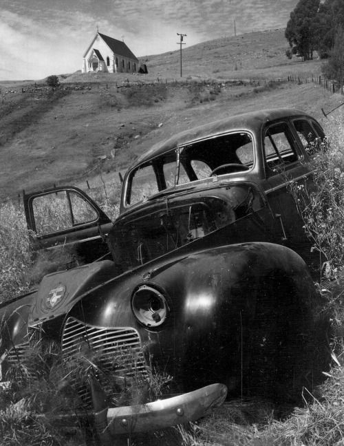 by Ansel Adams Church and Abandoned Automobile, Tiburon, California, 1957.
