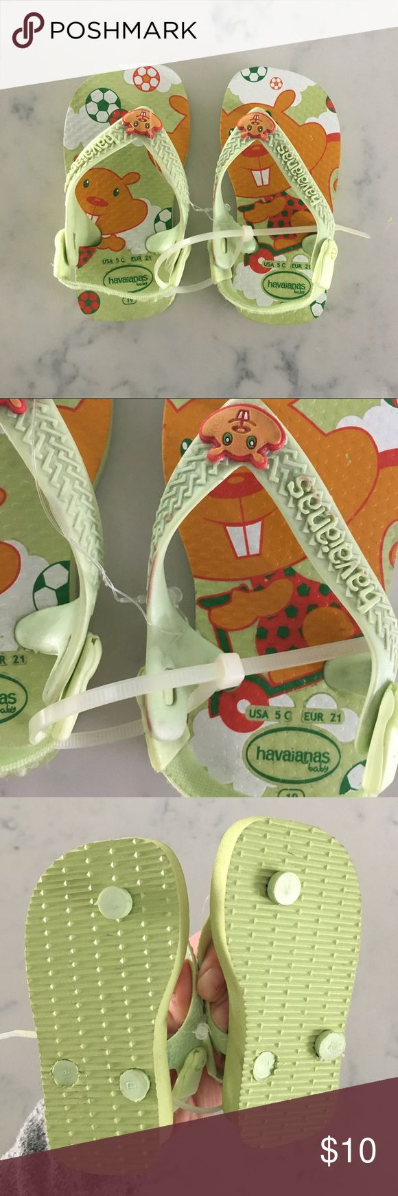 Baby Havaianas flip flops New, with very minor coloration flaws on the straps of one of the sandals, as pictured (they were there when I purchased them). Gender neutral. Havaianas Shoes Sandals & Flip Flops