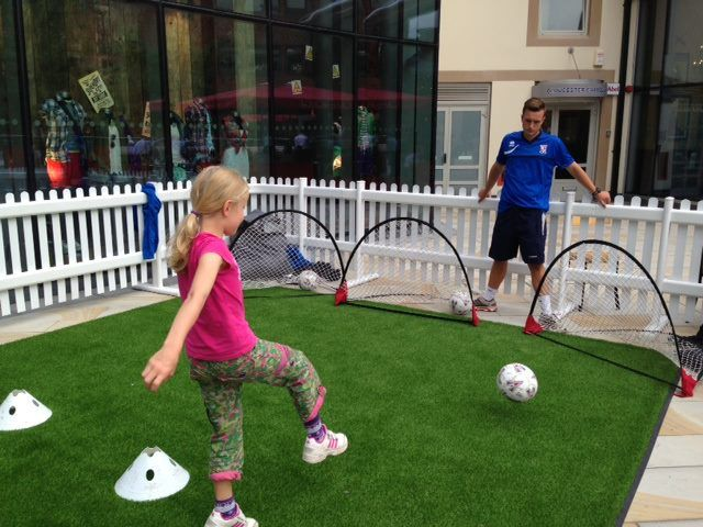 Woking FC teach the kids their football skills on the lawn, Jubilee Square, Woking.  #Woking #FC #Football #Kids #Surrey #Shopping #Sports #StayActive.