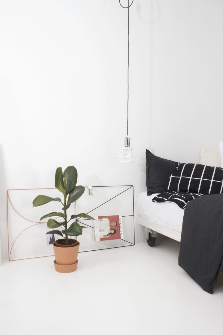 Nordic simplicity | Scandinavian style bedroom | Arrow Grid magazine rack and Bow Grid metal wire bulletin board by Wallment | New Finnish design