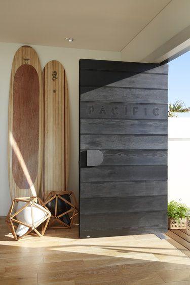 Big black door. Front door. Coastal home.