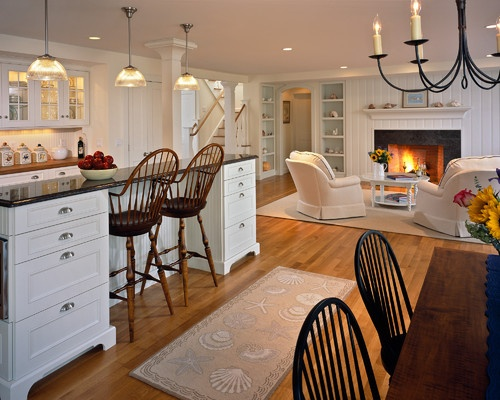 I don't like all the white, but I like the cozy feel of kitchen, hearth room and dining all together.