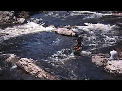 Whitewater canoe poling Maine guide Lisa DeHart