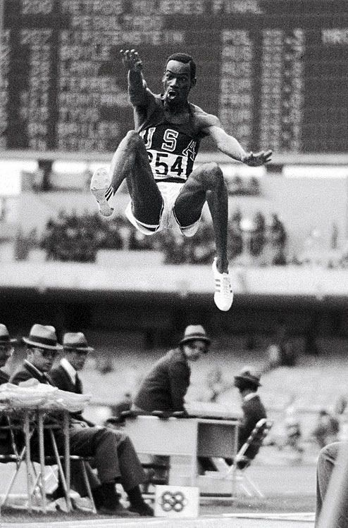 <p>U.S. track and field athlete Bob Beamon flies through the air during his world record long jump of 8.9 meters at the 1968 Summer Olympics in Mexico City. Beamon's jump, which inspired a new adjective for spectacular feats ('Beamonesque'), stood as the world record for 23 years.</p>