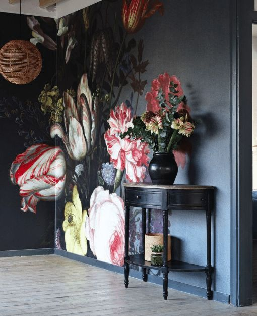 Bold floral wall mural on black background - dark and moody florals and unusual wallpaper are two of our top interior design trends of 2017. Read our feature for more ideas.