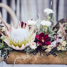 A gorgeous styled shoot incorporating proteas and African colours and textures, as well as a touch of gold glam.