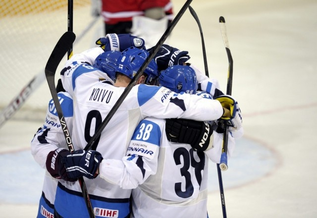 Finland's captain Mikko Koivu #9 celebrates with team mates after Koivu scored team's second goal during the Group H preliminary game Finland vs Canada in the 2012 IIHF Ice Hockey World Championships in Helsinki, Finland on May 11, 2012.