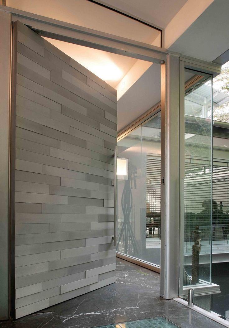 porte d'entrée design à effet parement e ardoise naturelles et sol en marbre