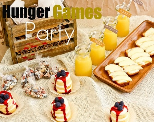 """""""Fun party food like Cookies from Peeta's Dad, Chocolate Rock Favor bags, goat cheese on bread, poisonous berry mini cake"""".  SERIOUSLY???  Here kids!  Have some POISONOUS BERRY mini cake!!!  Then, we'll go outside & hunt you for sport!"""