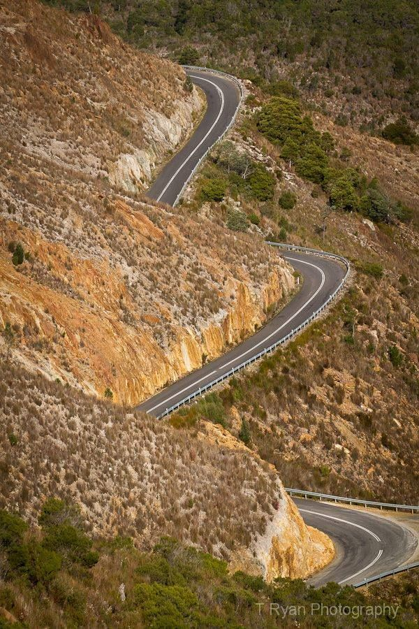 The Lyell Highway weaving its way through the hills of Queenstown on Tasmania's west coast.