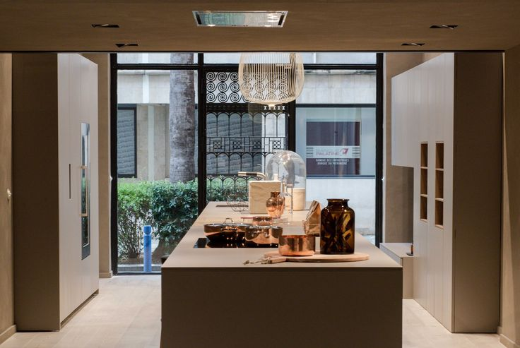 On display, a version featuring a central island with matching base cabinets and column units in silk-effect clay-coloured lacquer and light cereal-coloured oak.  #design #kitchen #interiors #interiordesign