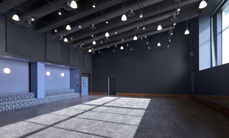 Dance studio. Really like the use of the industrial space and the built in benches