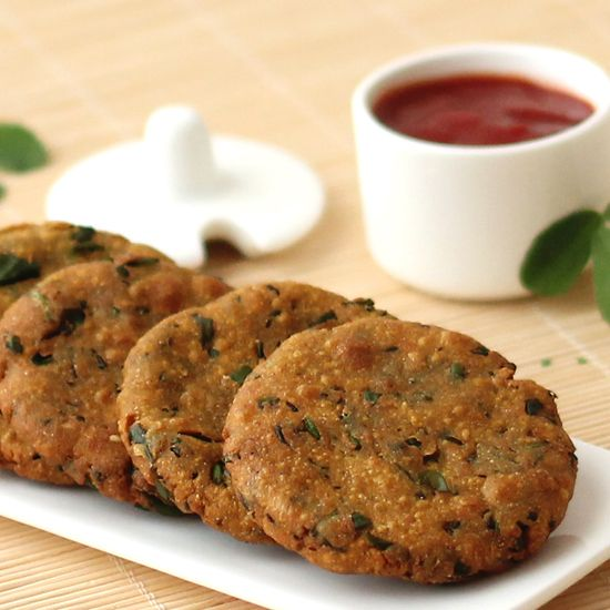 Bajri Methi Dhebra - Deep fried Gujarati snack made from millet flour, fenugreek leaves and basic Indian spices.